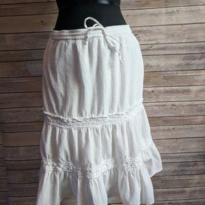White knee length frilly skirt with tie at waist